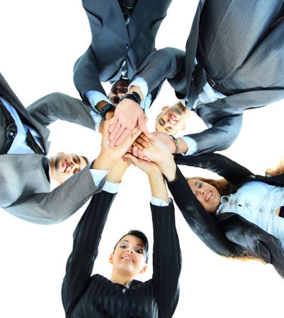 office party: Closeup portrait of group of business people with hands together Stock Photo