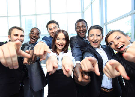 people in office: Portrait of excited young business people pointing at you Stock Photo