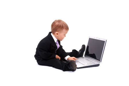 Little child and laptop Isolated on white background Stock Photo - 22335324