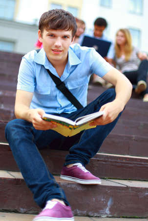 young man read book photo