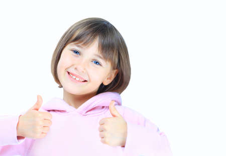 a little girl with thumb up isolated on white background photo