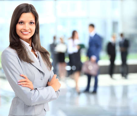 successful business woman: Business woman portrait smiling in an officeq Stock Photo