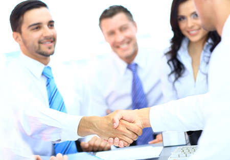 joined hands: Business people shaking hands at a meeting