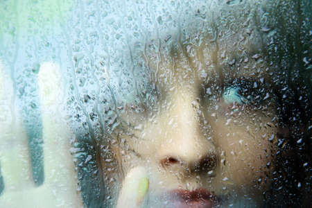 Sad young woman and a rain drops Stock Photo - 22335367