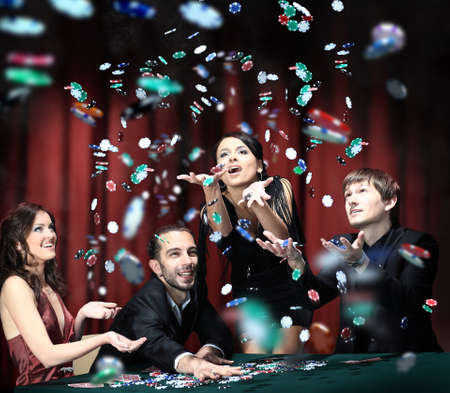 poker table: Young people have a good time in casino