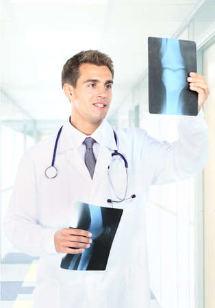 Happy doctor looking at x-ray photo