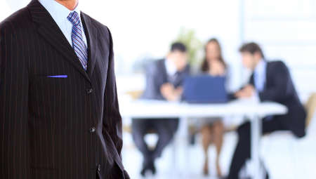 team leader: business man standing in an office Stock Photo