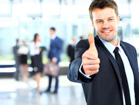 thumbs up: Businessman showing OK sign with his thumb up. Selective focus on face. Stock Photo