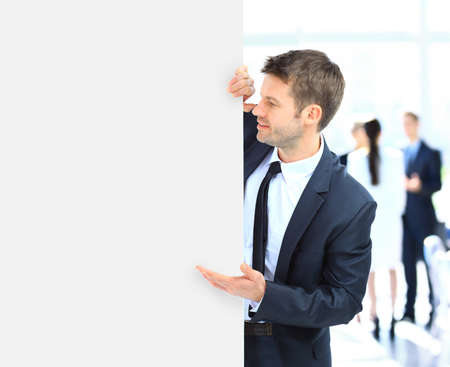 Business man holding a long blank banner photo