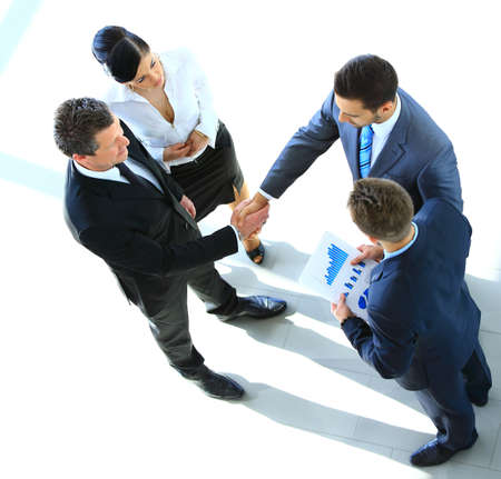 multi ethnic groups: Top view of a successful business leaders finalizing a deal at office