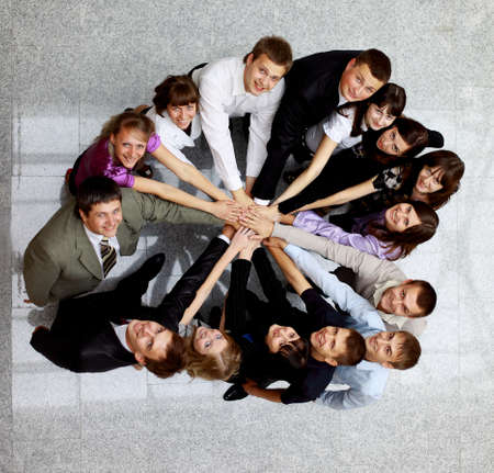 frendship: Top view of business people with their hands together in a circle