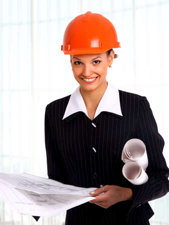 Female architect holding blueprints   Stock Photo - 22402279