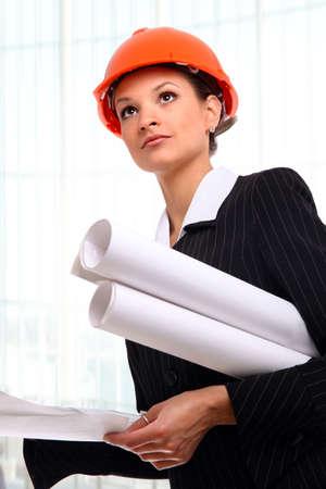 Female architect holding blueprints Stock Photo - 22402387