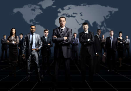 team leader: business team formed of young businessmen standing over a dark background Stock Photo