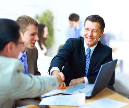 consensus: Business people shaking hands, finishing up a meeting