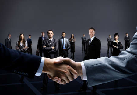 partnership power: handshake isolated on business background