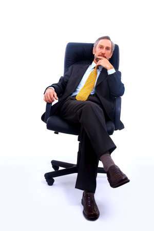man in chair: businessman isolated on white bacground
