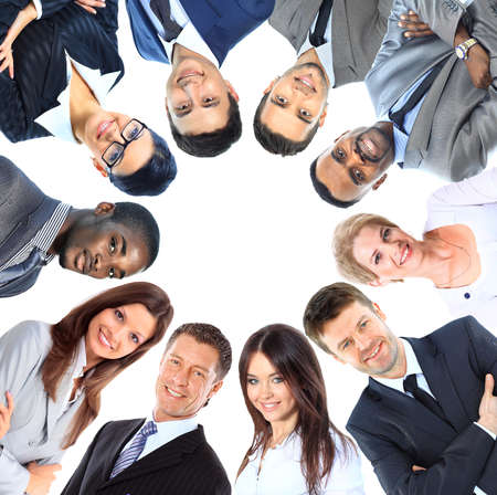 professionals: Group of business people standing in huddle, smiling, low angle view Stock Photo