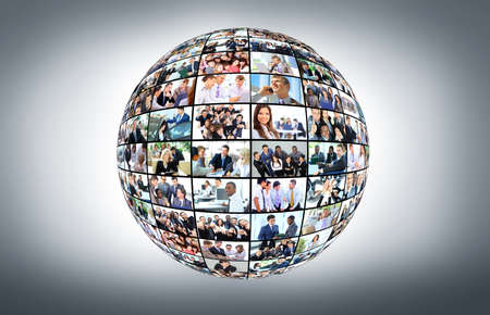 A globe is isolated on a white background with many different business people photo