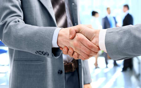 corporate meeting: Close up of businessmen shaking hands Stock Photo