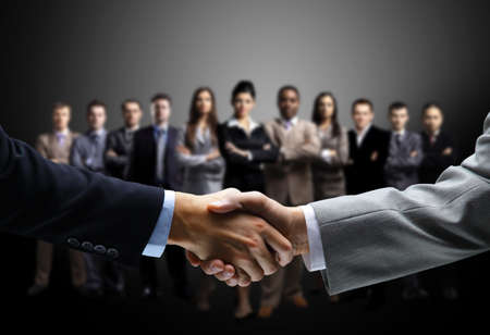 black handshake: handshake isolated on business background