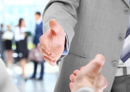 Close up of businessmen shaking hands photo