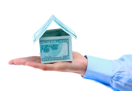 hands holding house: The house money in human hands