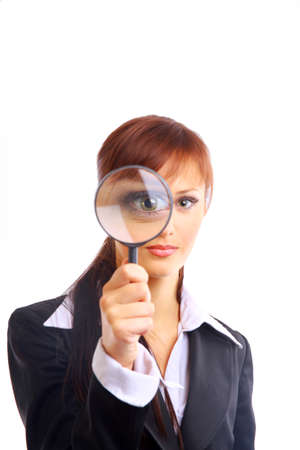 looking glass: young attractive Smiling woman looking into a magniying glass