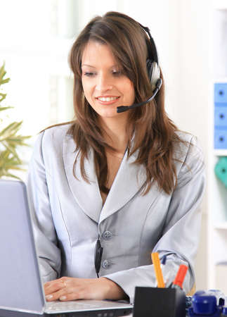 outworking: Happy woman calling on phone at home office