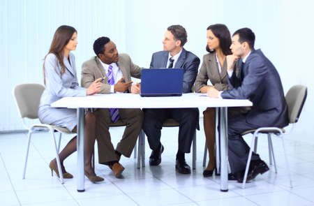meeting table: Leader with his successful team discussing in conference room