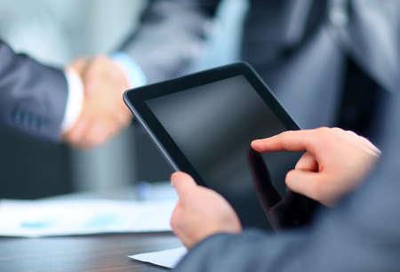 business concept: Businessman holding digital tablet Stock Photo