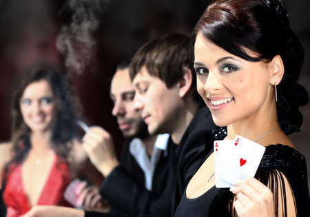 Poker players sitting around a table at a casino photo