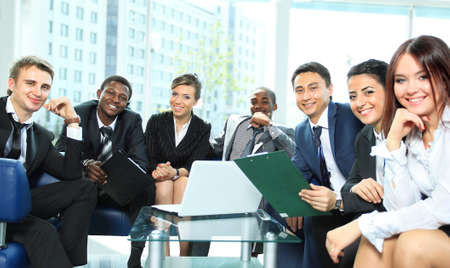 diversity people: Satisfied proud business team looking at camera and smiling in office Stock Photo