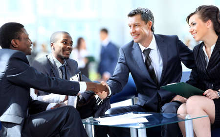 meeting: Business people shaking hands, finishing up a meeting Stock Photo