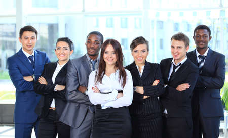 Happy young business woman with her team  Stock Photo