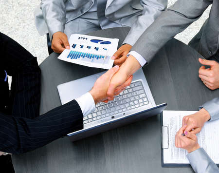business: Business people shaking hands, finishing up a meeting Stock Photo