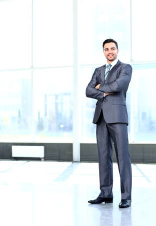 one mid adult man: Full body portrait of young happy smiling cheerful business man Stock Photo