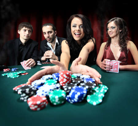 casino table: Stylish woman wins in the casino Stock Photo