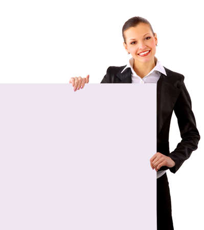 Businesswoman standing and holding a white empty billboard photo