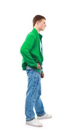 outstretched arms: Young man standing with hands in pockets