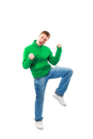 casual man looking very happy with his arms up photo