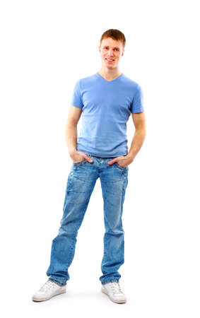 full body shot: Young man standing with hands in pockets