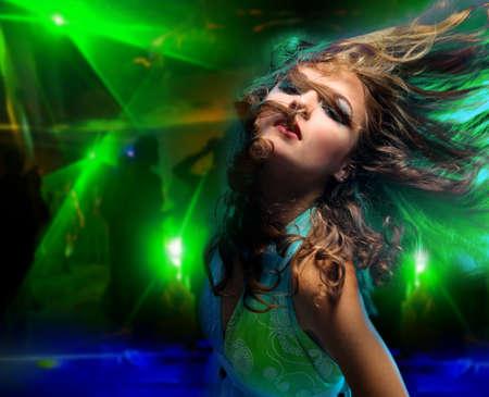 dancing girl: Beautiful young woman dancing in the nightclub  Stock Photo