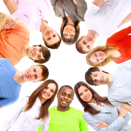 Low angle view of happy men and women standing together in a circle  photo