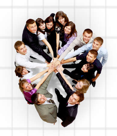 associates: Top view of business people with their hands together in a circle