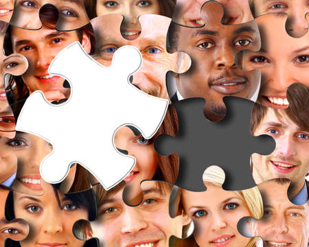 brainteaser: Group of business people in pieces of a puzzle  Stock Photo