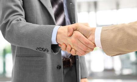 business handshake: handshake isolated in office  Stock Photo