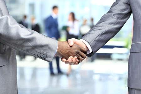 Handshake business: Handshake in front of business people Stock Photo