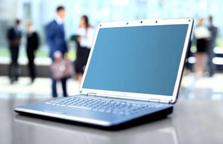 office window view: laptop on office desk Stock Photo