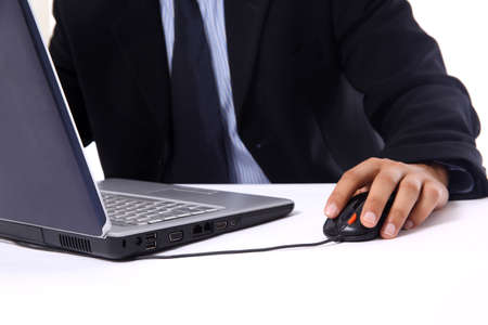 businessman sitting by desk at office working on the laptop  photo